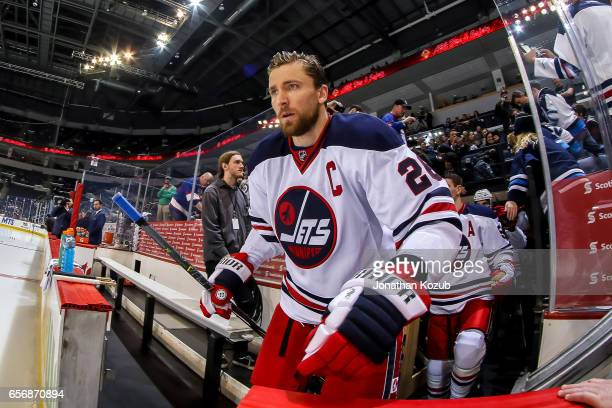 Blake Wheeler of the Winnipeg Jets hits the ice for the pregame warm up prior to NHL action against the Minnesota Wild at the MTS Centre on March 19...