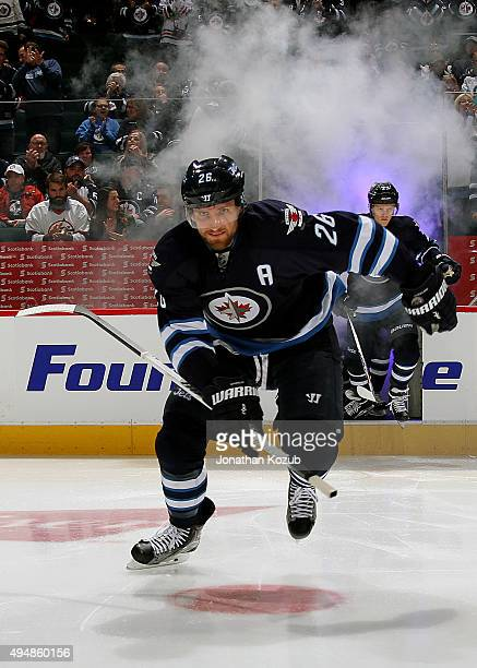 Blake Wheeler of the Winnipeg Jets hits the ice prior to puck drop against the Chicago Blackhawks at the MTS Centre on October 29 2015 in Winnipeg...