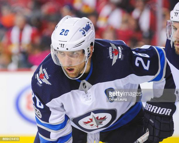 Blake Wheeler of the Winnipeg Jets in action against the Calgary Flames during an NHL game at Scotiabank Saddledome on October 7 2017 in Calgary...