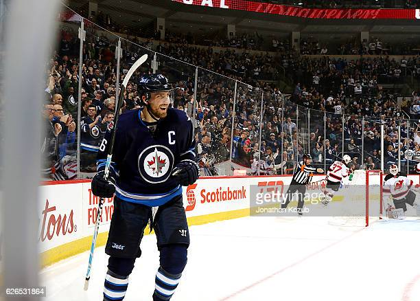 Blake Wheeler of the Winnipeg Jets is all smiles as he celebrates his second period goal against the New Jersey Devils at the MTS Centre on November...