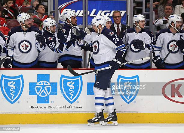 Blake Wheeler of the Winnipeg Jets is congratulated by teammates after scoring a third period goal against the Chicago Blackhawks at the United...