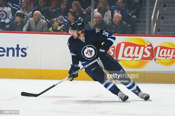 Blake Wheeler of the Winnipeg Jets keeps an eye on the play during first period action against the Los Angeles Kings in the home opener at the MTS...