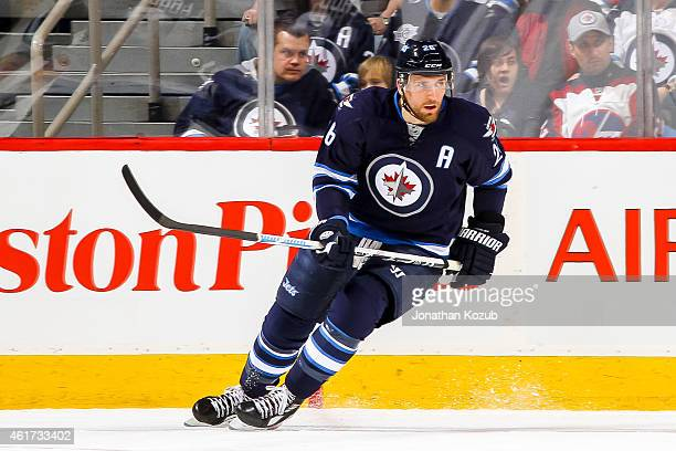 Blake Wheeler of the Winnipeg Jets keeps an eye on the play during first period against the Florida Panthers on January 13 2015 at the MTS Centre in...