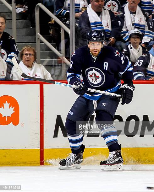 Blake Wheeler of the Winnipeg Jets keeps an eye on the play during first period action against the Minnesota Wild at the MTS Centre on October 25...