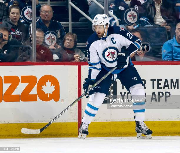 Blake Wheeler of the Winnipeg Jets keeps an eye on the play during first period action against the Anaheim Ducks at the MTS Centre on March 30 2017...