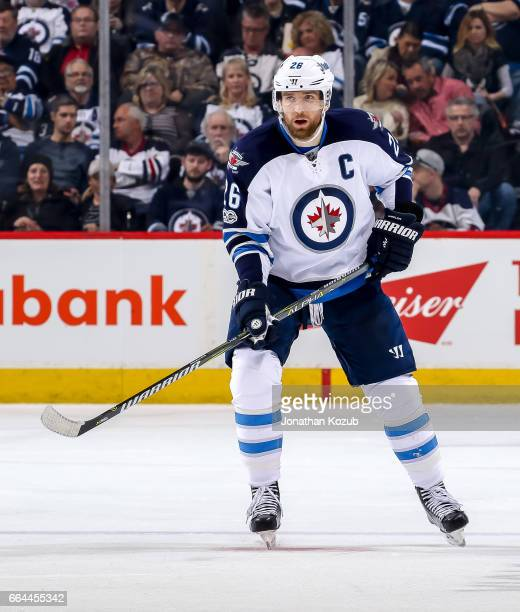 Blake Wheeler of the Winnipeg Jets keeps an eye on the play during second period action against the Anaheim Ducks at the MTS Centre on March 30 2017...