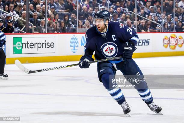 Blake Wheeler of the Winnipeg Jets keeps an eye on the play during third period action against the Ottawa Senators at the MTS Centre on April 1 2017...