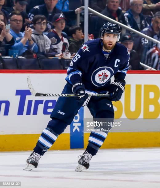 Blake Wheeler of the Winnipeg Jets keeps an eye on the play during second period action against the Nashville Predators at the MTS Centre on April 8...
