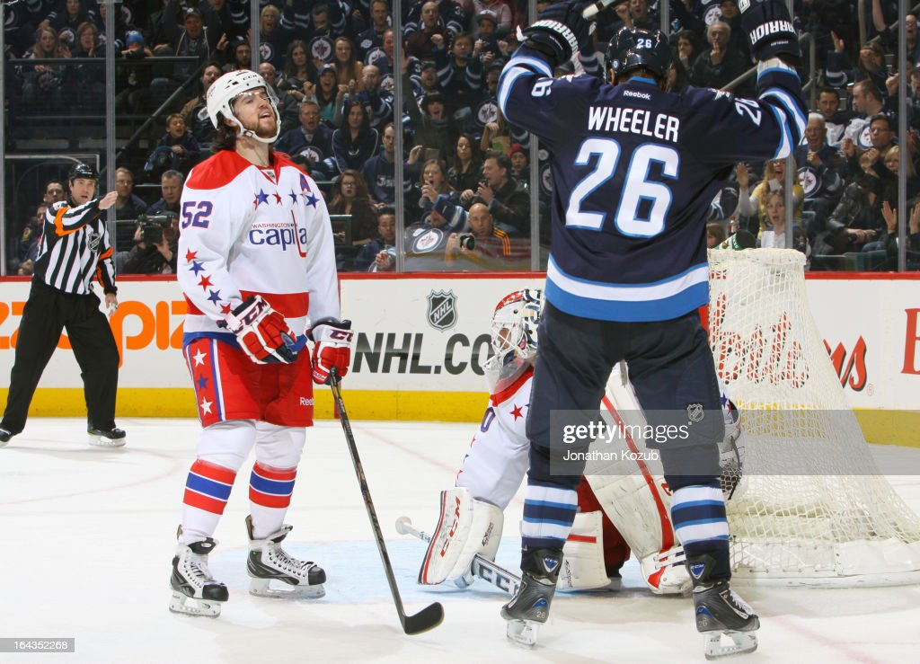 <a gi-track='captionPersonalityLinkClicked' href=/galleries/search?phrase=Blake+Wheeler&family=editorial&specificpeople=716703 ng-click='$event.stopPropagation()'>Blake Wheeler</a> #26 of the Winnipeg Jets lifts his arms in celebration as defenseman Mike Green #52 of the Washington Capitals reacts to a third period goal against at the MTS Centre on March 22, 2013 in Winnipeg, Manitoba, Canada.