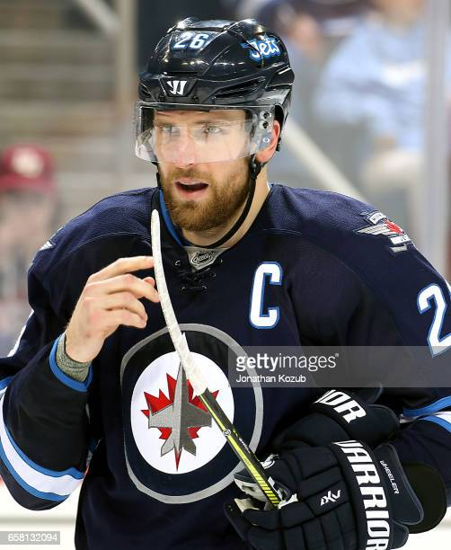 Blake Wheeler of the Winnipeg Jets looks on during a third period stoppage in play against the Vancouver Canucks at the MTS Centre on March 26 2017...