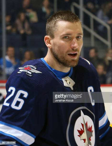 Blake Wheeler of the Winnipeg Jets looks on during the pregame warm up prior to NHL action against the Carolina Hurricanes at the Bell MTS Place on...