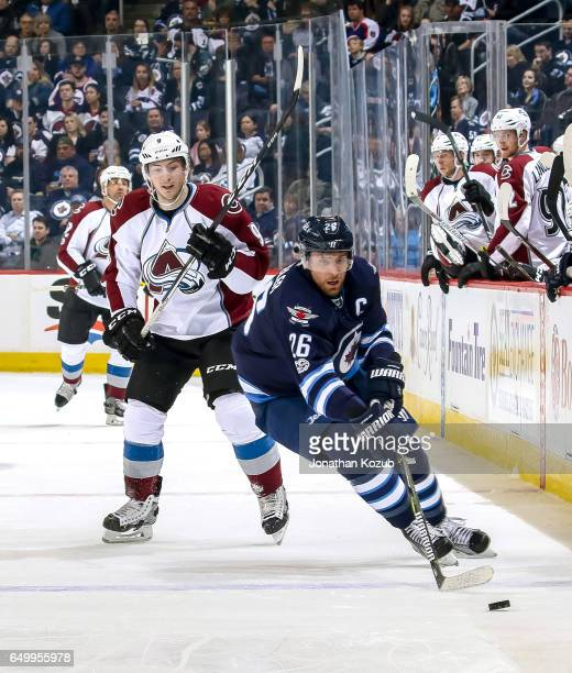 Blake Wheeler of the Winnipeg Jets plays the puck as Matt Duchene of the Colorado Avalanche gives chase during first period action at the MTS Centre...