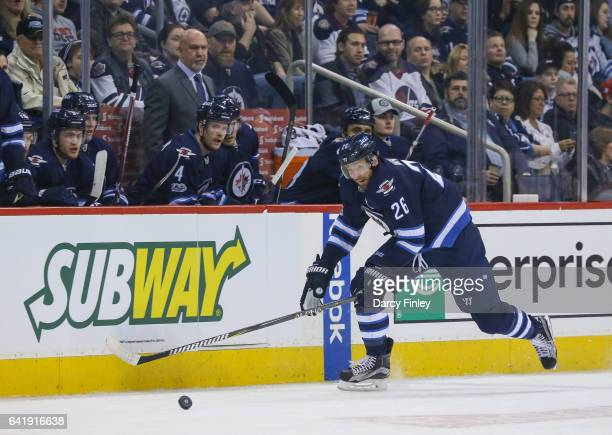 Blake Wheeler of the Winnipeg Jets plays the puck down the ice during first period action against the Tampa Bay Lightning at the MTS Centre on...