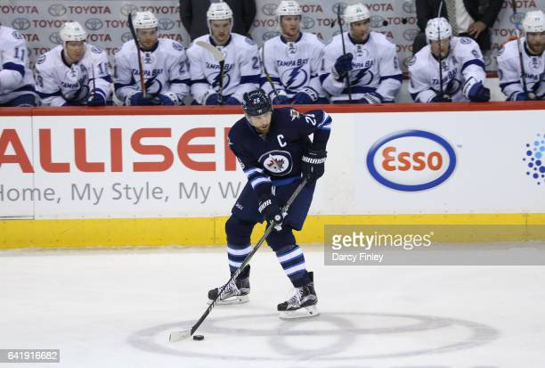 Blake Wheeler of the Winnipeg Jets plays the puck down the ice during second period action against the Tampa Bay Lightning at the MTS Centre on...