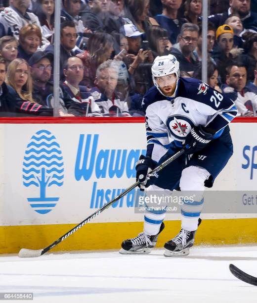 Blake Wheeler of the Winnipeg Jets plays the puck down the ice during second period action against the Anaheim Ducks at the MTS Centre on March 30...