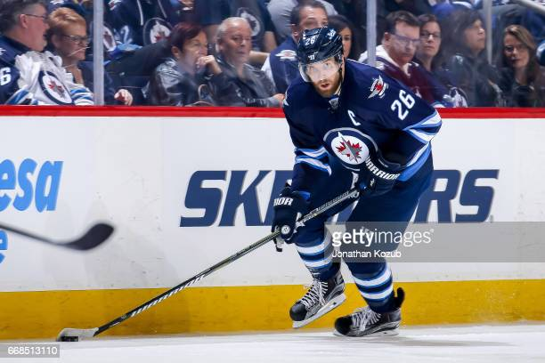 Blake Wheeler of the Winnipeg Jets plays the puck down the ice during second period action against the Nashville Predators at the MTS Centre on April...