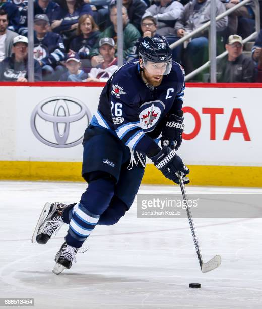Blake Wheeler of the Winnipeg Jets plays the puck down the ice during third period action against the Nashville Predators at the MTS Centre on April...