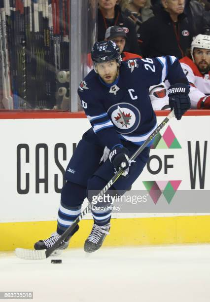 Blake Wheeler of the Winnipeg Jets plays the puck down the ice during first period action against the Carolina Hurricanes at the Bell MTS Place on...