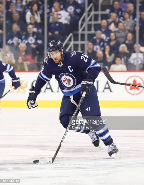Blake Wheeler of the Winnipeg Jets plays the puck down the ice during third period action against the Vegas Golden Knights at the Bell MTS Place on...