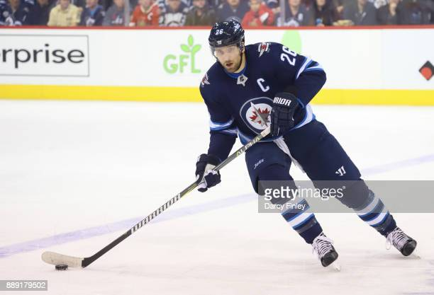 Blake Wheeler of the Winnipeg Jets plays the puck up the ice during first period action against the Ottawa Senators at the Bell MTS Place on December...