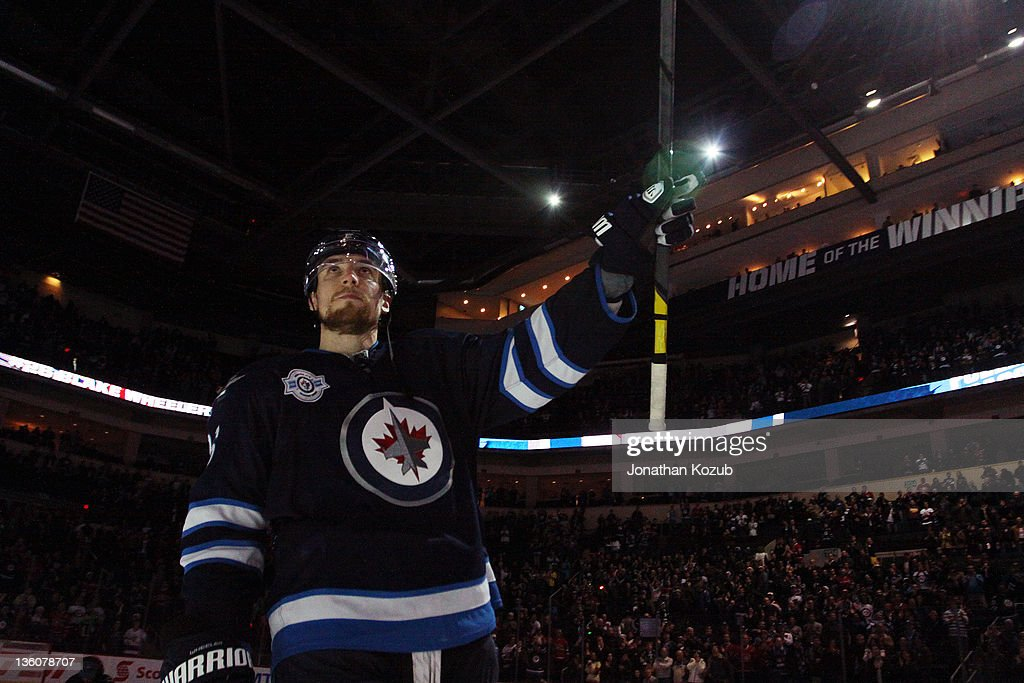 <a gi-track='captionPersonalityLinkClicked' href=/galleries/search?phrase=Blake+Wheeler&family=editorial&specificpeople=716703 ng-click='$event.stopPropagation()'>Blake Wheeler</a> #26 of the Winnipeg Jets salutes the fans after first star honors following a two goal performance in a 4-0 defeat over the Montreal Canadiens at the MTS Centre on December 22, 2011 in Winnipeg, Manitoba, Canada.