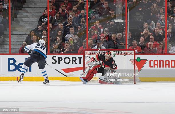 Blake Wheeler of the Winnipeg Jets scores a shoot out goal against Craig Anderson of the Ottawa Senators at Canadian Tire Centre on November 5 2015...
