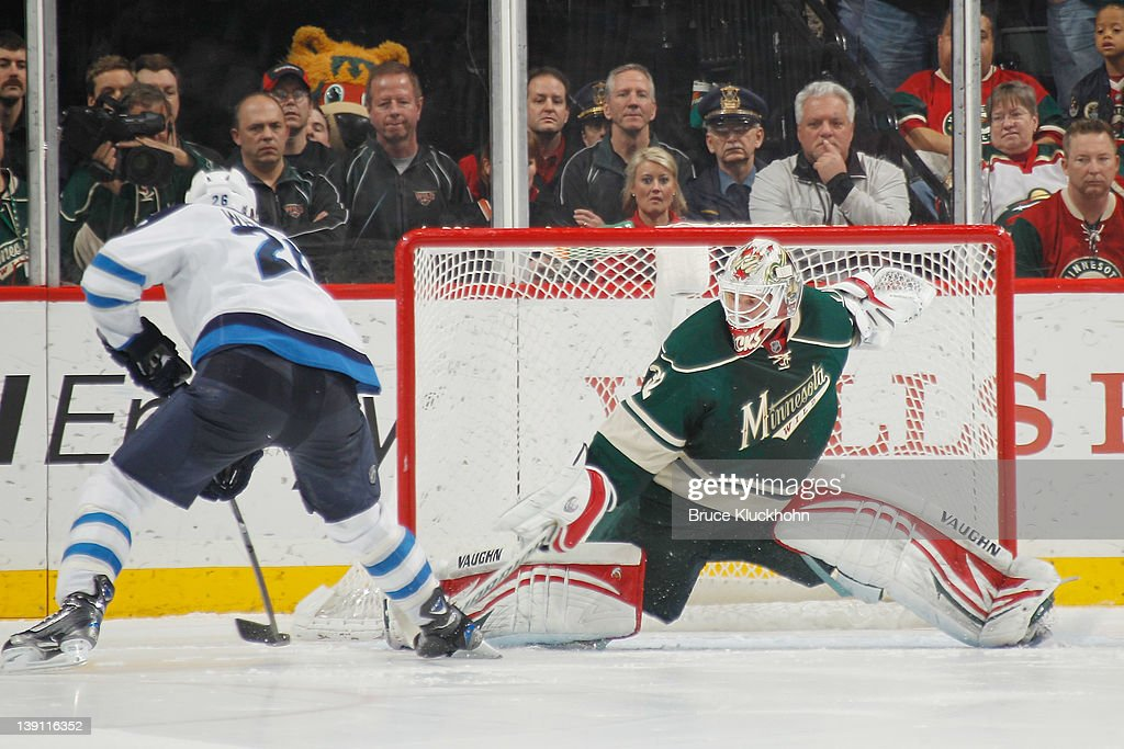 <a gi-track='captionPersonalityLinkClicked' href=/galleries/search?phrase=Blake+Wheeler&family=editorial&specificpeople=716703 ng-click='$event.stopPropagation()'>Blake Wheeler</a> #26 of the Winnipeg Jets scores a shootout goal against Niklas Backstrom #32 of the Minnesota Wild during the game at the Xcel Energy Center on February 16, 2012 in St. Paul, Minnesota.