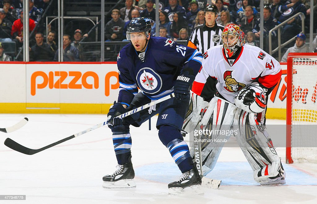 <a gi-track='captionPersonalityLinkClicked' href=/galleries/search?phrase=Blake+Wheeler&family=editorial&specificpeople=716703 ng-click='$event.stopPropagation()'>Blake Wheeler</a> #26 of the Winnipeg Jets sets a screen in front of goaltender <a gi-track='captionPersonalityLinkClicked' href=/galleries/search?phrase=Craig+Anderson&family=editorial&specificpeople=211238 ng-click='$event.stopPropagation()'>Craig Anderson</a> #41 of the Ottawa Senators during third period action at the MTS Centre on March 8, 2014 in Winnipeg, Manitoba, Canada.