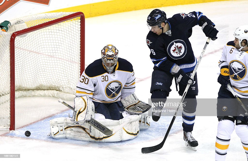 Blake Wheeler #26 of the Winnipeg Jets shoots against goaltender Ryan Miller #30 of the Buffalo Sabres during first-period action on April 9, 2013 at the MTS Centre in Winnipeg, Manitoba, Canada.