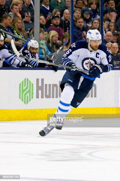 Blake Wheeler of the Winnipeg Jets skates after the puck during the game against the Columbus Blue Jackets on April 6 2017 at Nationwide Arena in...