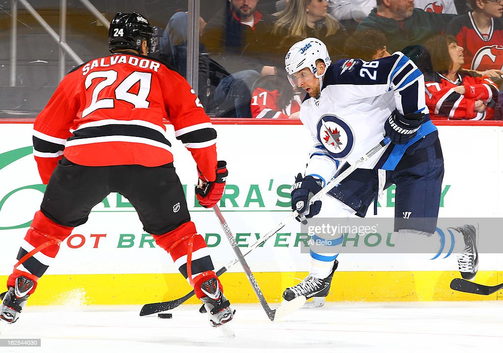 Blake Wheeler #26 of the Winnipeg Jets skates against <a gi-track='captionPersonalityLinkClicked' href=/galleries/search?phrase=Bryce+Salvador&family=editorial&specificpeople=208746 ng-click='$event.stopPropagation()'>Bryce Salvador</a> #24 of the New Jersey Devils during their game at the Prudential Center on February 24, 2013 in Newark, New Jersey.