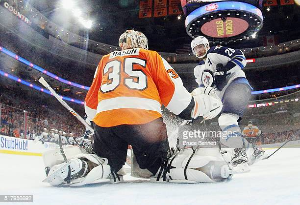 Blake Wheeler of the Winnipeg Jets skates against Steve Mason of the Philadelphia Flyers at the Wells Fargo Center on March 28 2016 in Philadelphia...