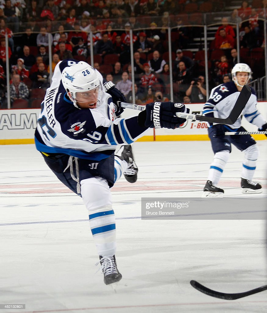 <a gi-track='captionPersonalityLinkClicked' href=/galleries/search?phrase=Blake+Wheeler&family=editorial&specificpeople=716703 ng-click='$event.stopPropagation()'>Blake Wheeler</a> #26 of the Winnipeg Jets skates against the New Jersey Devils at the Prudential Center on November 25, 2013 in Newark, New Jersey. The Jets defeated the Devils 3-1.