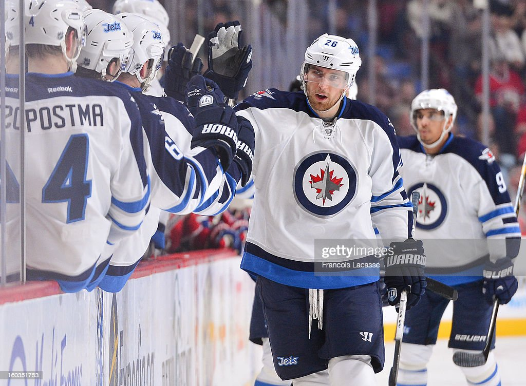<a gi-track='captionPersonalityLinkClicked' href=/galleries/search?phrase=Blake+Wheeler&family=editorial&specificpeople=716703 ng-click='$event.stopPropagation()'>Blake Wheeler</a> #26 of the Winnipeg Jets skates by his bench following a second-period goal against the Montreal Canadiens during the NHL game on January 29, 2013 at the Bell Centre in Montreal, Quebec, Canada.