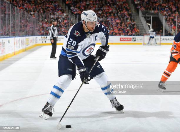 Blake Wheeler of the Winnipeg Jets skates during the game against the Edmonton Oilers on October 9 2017 at Rogers Place in Edmonton Alberta Canada