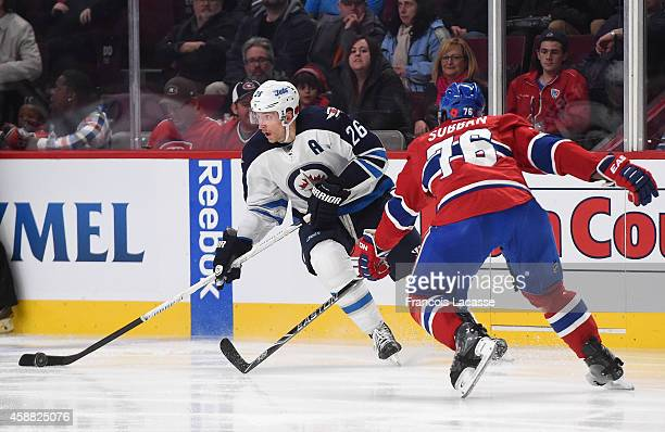 Blake Wheeler of the Winnipeg Jets skates with the puck while being challenged by PK Subban of the Montreal Canadiens in the NHL game at the Bell...