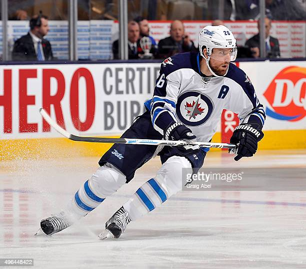 Blake Wheeler of the Winnipeg Jets turns up ice against the Toronto Maple Leafs during game action on November 4 2015 at Air Canada Centre in Toronto...