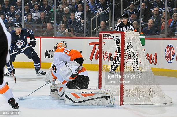 Blake Wheeler of the Winnipeg Jets watches as the puck flies into the net behind goaltender Rob Zepp of the Philadelphia Flyers on a shot by Dustin...