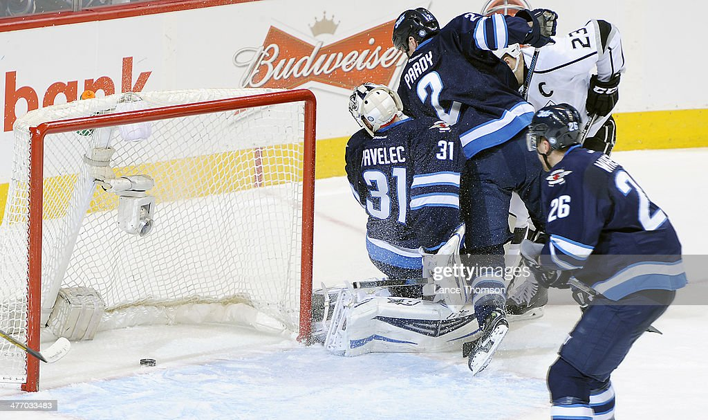 <a gi-track='captionPersonalityLinkClicked' href=/galleries/search?phrase=Blake+Wheeler&family=editorial&specificpeople=716703 ng-click='$event.stopPropagation()'>Blake Wheeler</a> #26 of the Winnipeg Jets watches as the puck slides into the empty net past teammate <a gi-track='captionPersonalityLinkClicked' href=/galleries/search?phrase=Ondrej+Pavelec&family=editorial&specificpeople=3644118 ng-click='$event.stopPropagation()'>Ondrej Pavelec</a> #31 for a second period goal by the Los Angeles Kings at the MTS Centre on March 6, 2014 in Winnipeg, Manitoba, Canada.