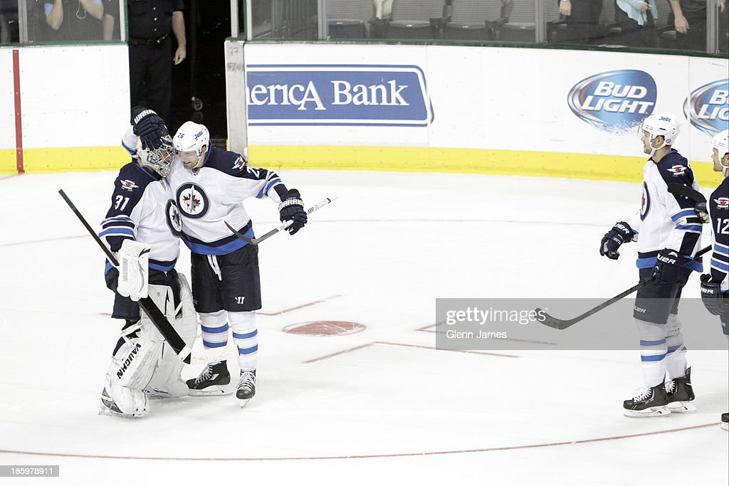 <a gi-track='captionPersonalityLinkClicked' href=/galleries/search?phrase=Blake+Wheeler&family=editorial&specificpeople=716703 ng-click='$event.stopPropagation()'>Blake Wheeler</a> #26, Ondrej Pavelec #31 and the Winnipeg Jets celebrate a shootout win against the Dallas Stars at the American Airlines Center on October 26, 2013 in Dallas, Texas.