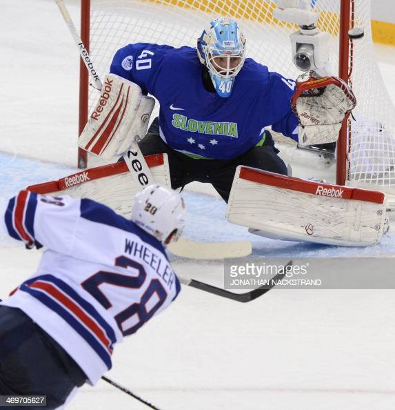 US Blake Wheeler tries to score on Slovenia's goalkeeper Luka Gracnar during the Men's Ice Hockey Group A match between Slovenia and USA at the...