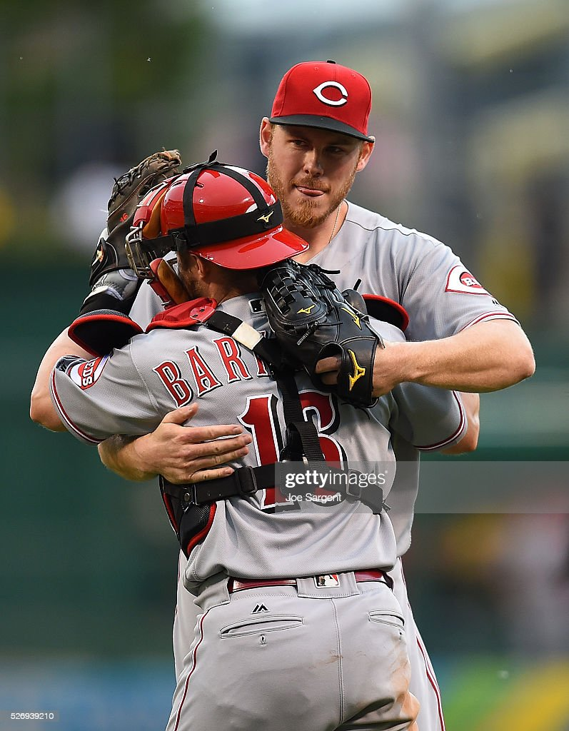 Blake Wood #36 celebrates with Tucker Barnhart #16 of the Cincinnati Reds after a 6-5 win over the Pittsburgh Pirates on May 1, 2016 at PNC Park in Pittsburgh, Pennsylvania.