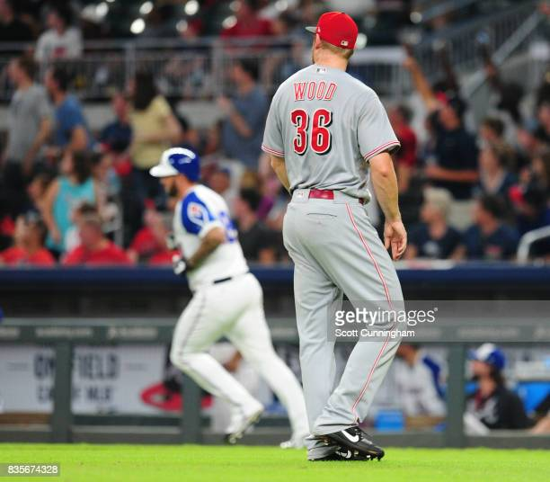 Blake Wood of the Cincinnati Reds watches as Matt Adams of the Atlanta Braves rounds the bases after hitting a ninth inning threerun inning at...