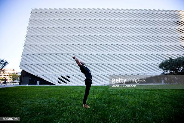 Blakey Olsen of Laguna Beach practices yoga in the shade of The Broad contemporary art museum amid hot weather downtown where temperatures set a...