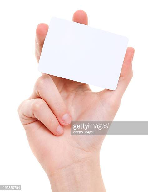 Blanc card in female hand on white
