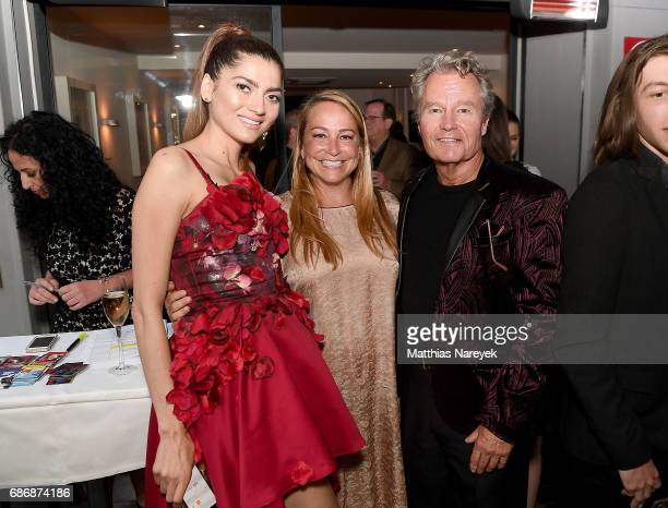 Blanca Blanco Emily Glassman and John Savage attend IMDb's 2017 Cannes dinner party at Table 22 on May 22 2017 in Cannes France