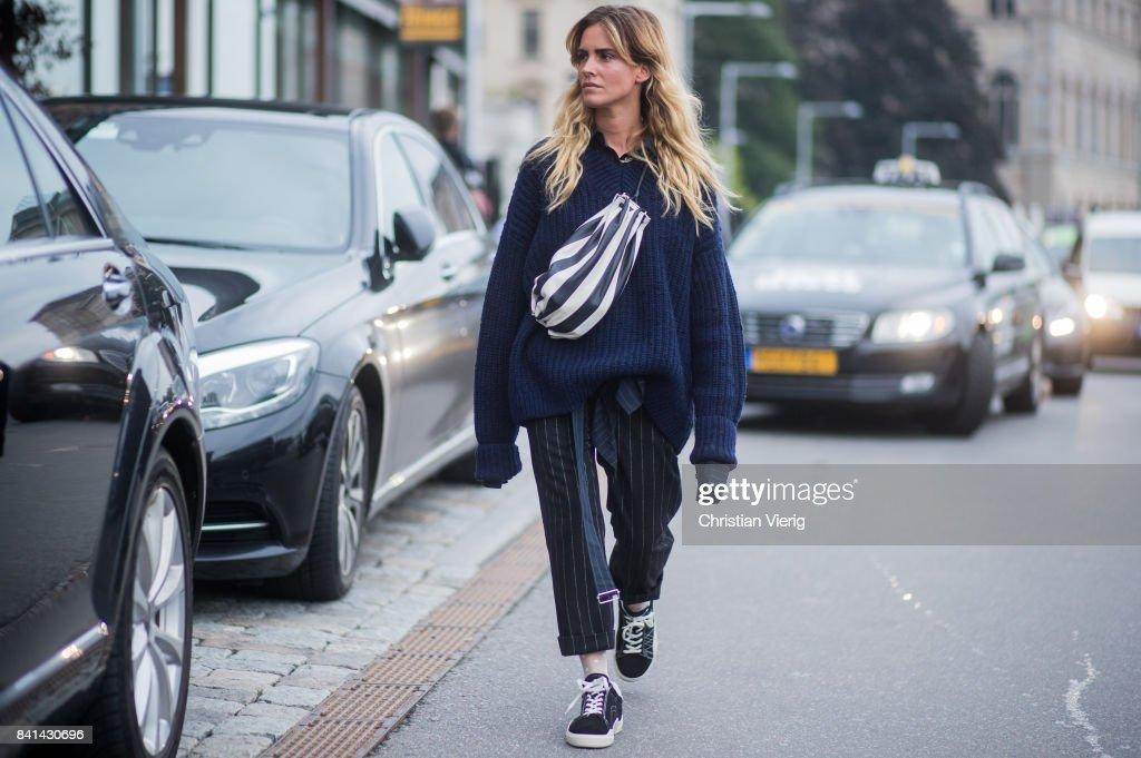 Blanca Miro Scimieri wearing a belt bag, oversized navy knit, striped pants, Vans outside House of Dagmar on August 31, 2017 in Stockholm, Sweden.