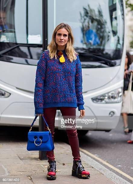 Blanca Miro Scrimieri wearing an Acne sweater JW Anderson bag Isabel Marant pants and Prada shoes outside of during London Fashion Week Spring/Summer...