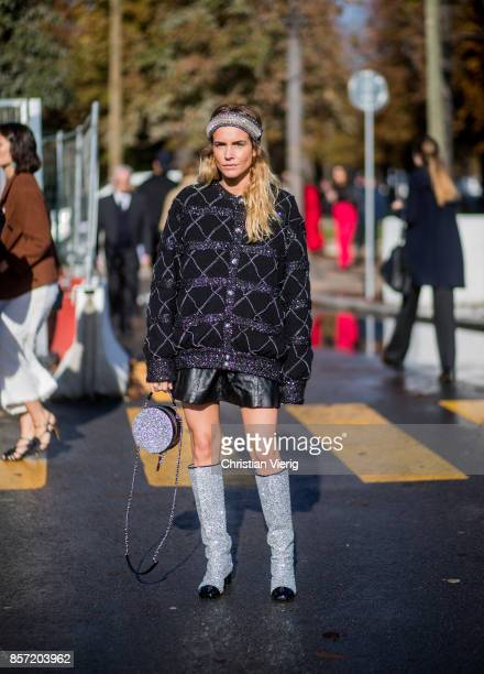 Blanca Miro Scrimieri wearing Chanel glitter boots bag jacket mini skirt seen outside Chanel during Paris Fashion Week Spring/Summer 2018 on October...