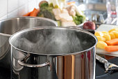 Blanching vegetables in big cooking pot preparation